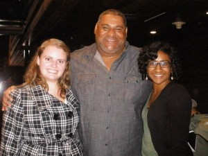 After an evening of laughter and tears, AKWorld Alyssa Bish and Meneka Thiru take a moment to get a photo with Chris Abani