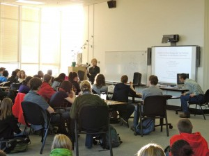 Dr. Thorning discusses economics with an interested group of students at West High School