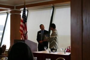 AKWorld Board Chair Garret Wong graciously receives a book from Ambassador Djalal (followed by a hug!)